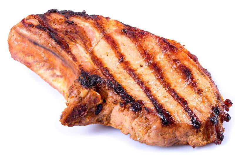 Côtelette de porc grillée sur le fond blanc Plan rapproché photographie stock