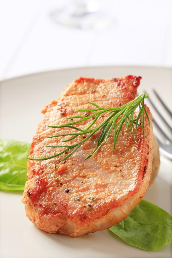 Côtelette de porc marinée photos stock