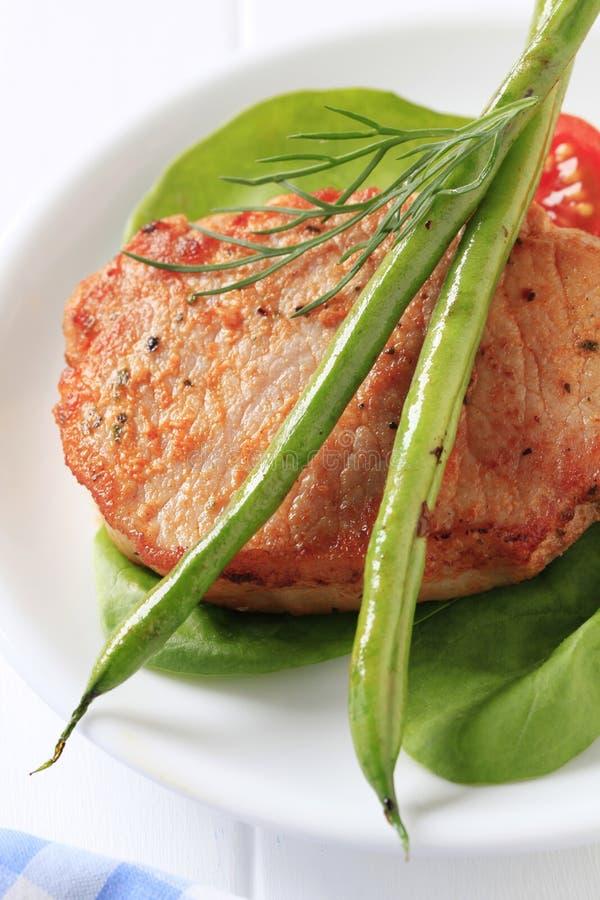 Côtelette de porc marinée images stock