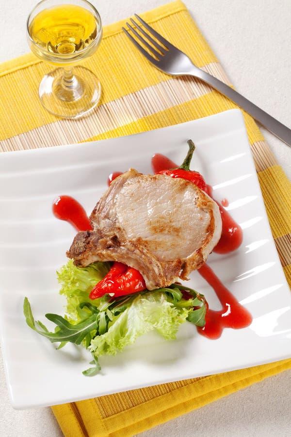 Côtelette et accompagnement de rôti de porc photographie stock libre de droits