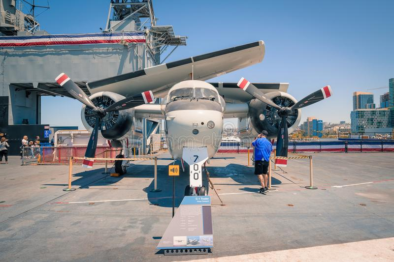 The C1 Trader Prop Plane On board Uss Midway aircraft carrier museum at the San Diego Harbor California clear summer day. The USS midway is a retired aircraft stock image