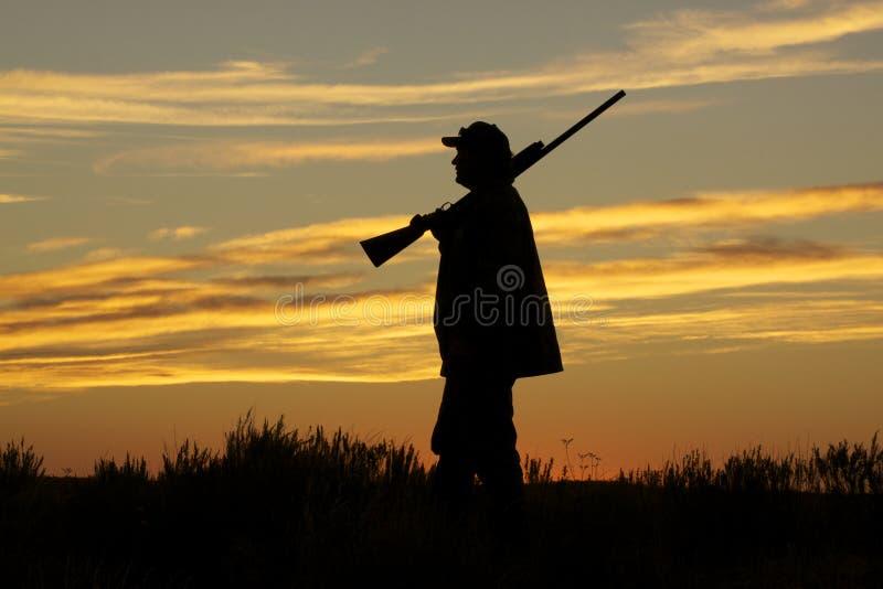 Caçador no por do sol fotografia de stock royalty free
