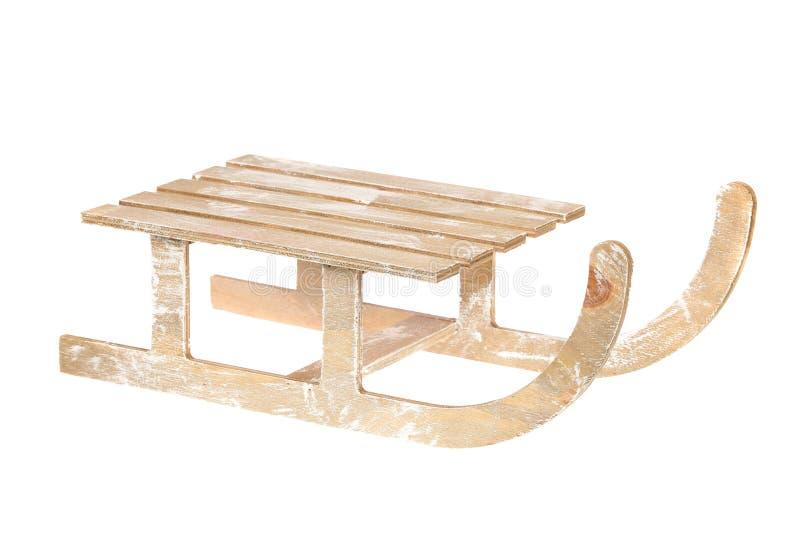 Caçoa o pequeno trenó de madeira pintado branco do vintage isolado no branco imagens de stock