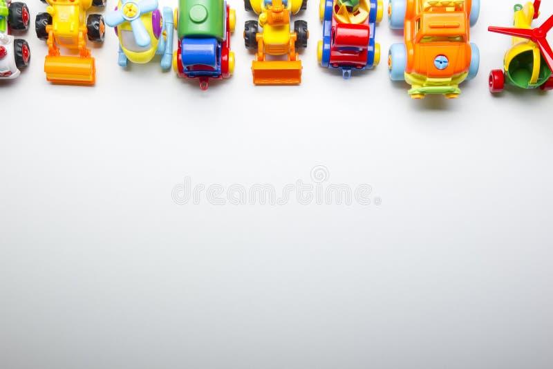 Caçoa o quadro tornando-se educacional dos brinquedos no fundo branco Vista superior Configuração lisa Copie o espaço para o text imagem de stock royalty free