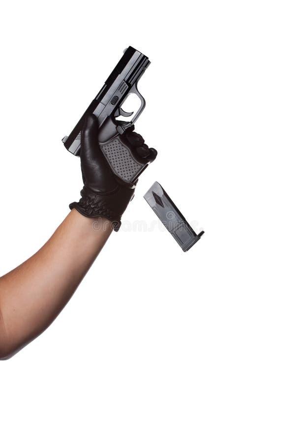 Caída de un clip de la arma de mano imagen de archivo