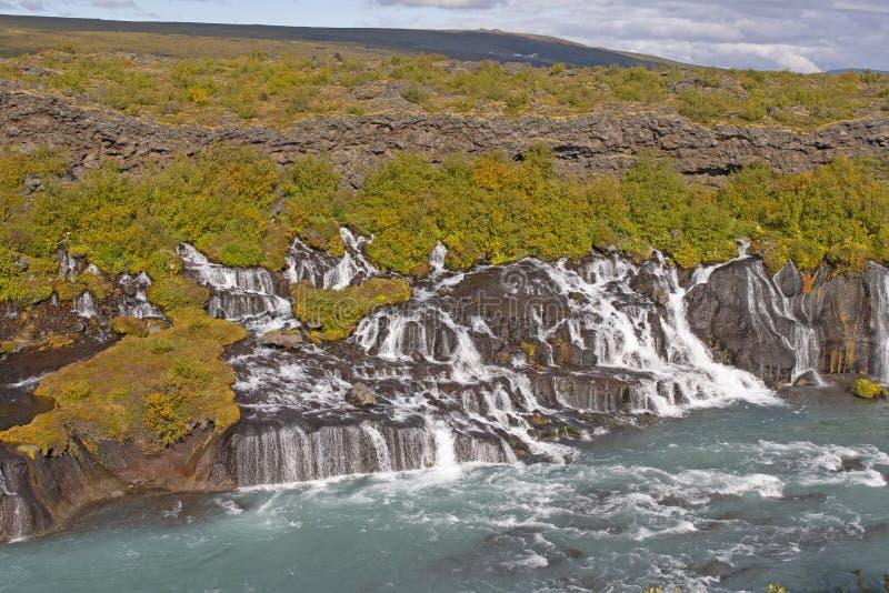 Caídas dramáticas que fluyen fuera de Lava Field foto de archivo libre de regalías