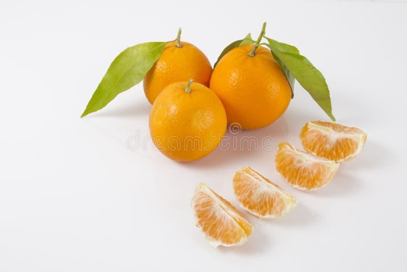 Całe tangerines lub mandarynki pomarańcze owoc zdjęcia stock