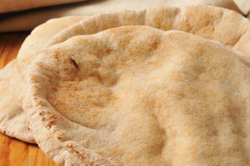 Cały pszeniczny pita chleb obrazy royalty free