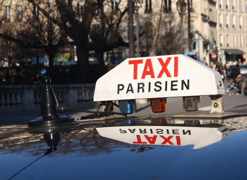 A cab in Paris. Picture taken in Paris, near a cab station, at Trinité place. Picture taken in 2011 royalty free stock photo