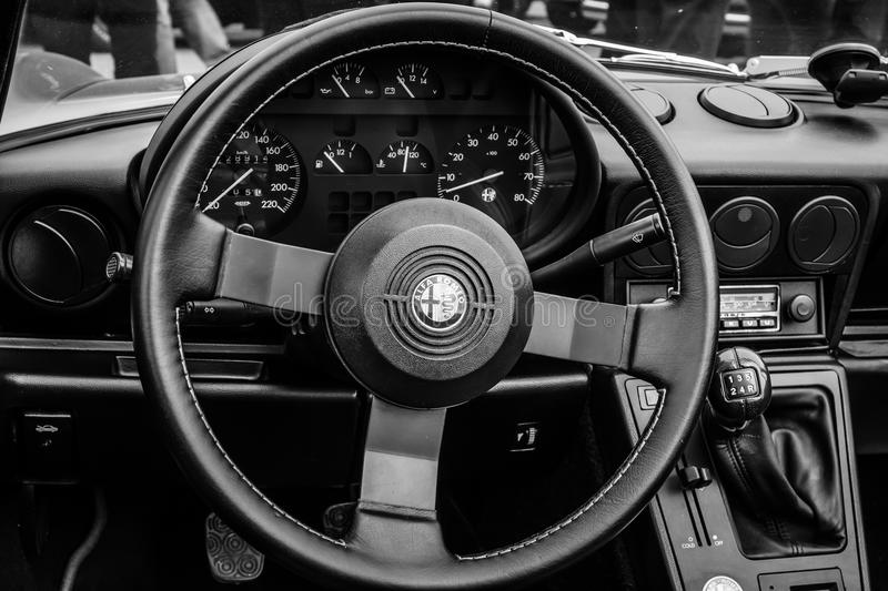 Cab of the roadster Alfa Romeo Spider. BERLIN, GERMANY - MAY 17, 2014: Cab of the roadster Alfa Romeo Spider (Third generation). Black and white. 27th Oldtimer stock photos