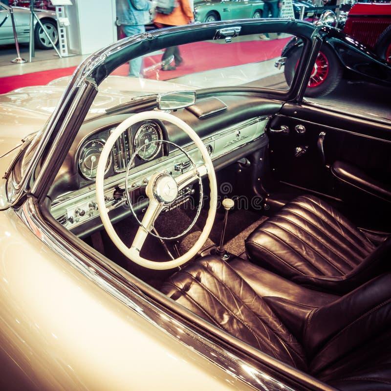Cab of roadster Mercedes-Benz 300SL (W198), 1957. STUTTGART, GERMANY- MARCH 17, 2016: Cab of roadster Mercedes-Benz 300SL (W198), 1957. Stylization. Toning stock photography