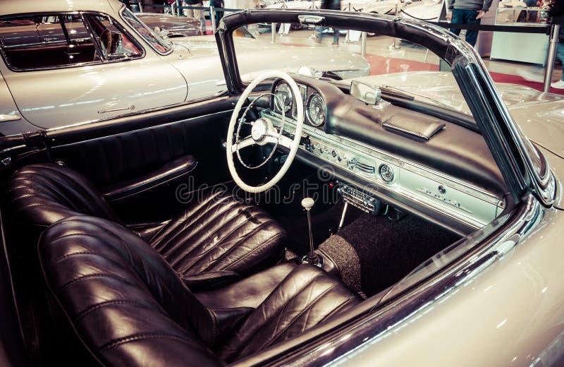 Cab of roadster Mercedes-Benz 300SL (W198), 1957. STUTTGART, GERMANY- MARCH 17, 2016: Cab of roadster Mercedes-Benz 300SL (W198), 1957. Stylization. Toning stock photos