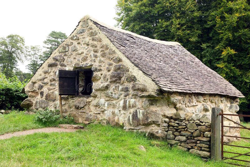 Cabaña de piedra vieja fotos de archivo
