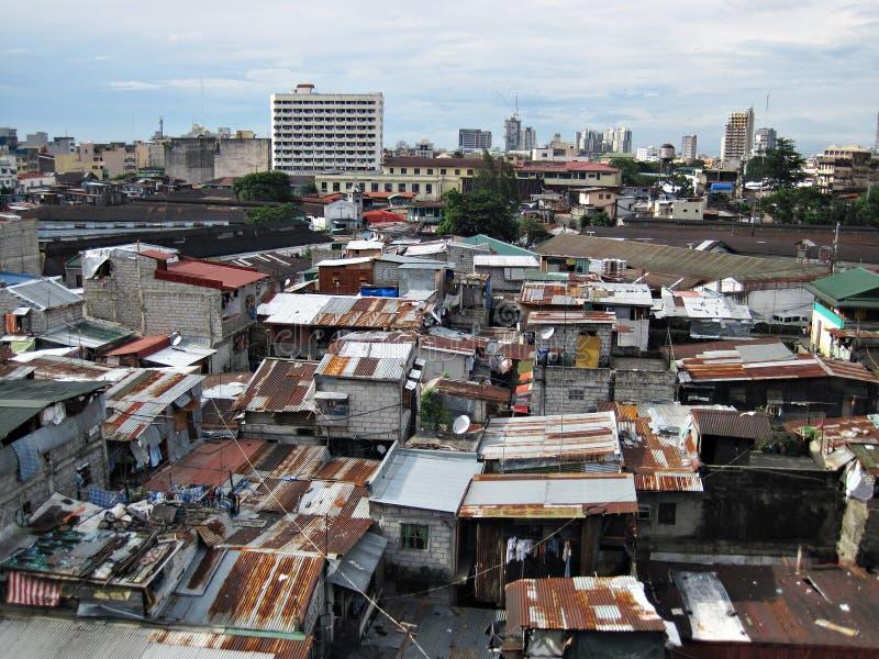 Cabañas y casas del ocupante en una zona urbana de los tugurios fotografía de archivo