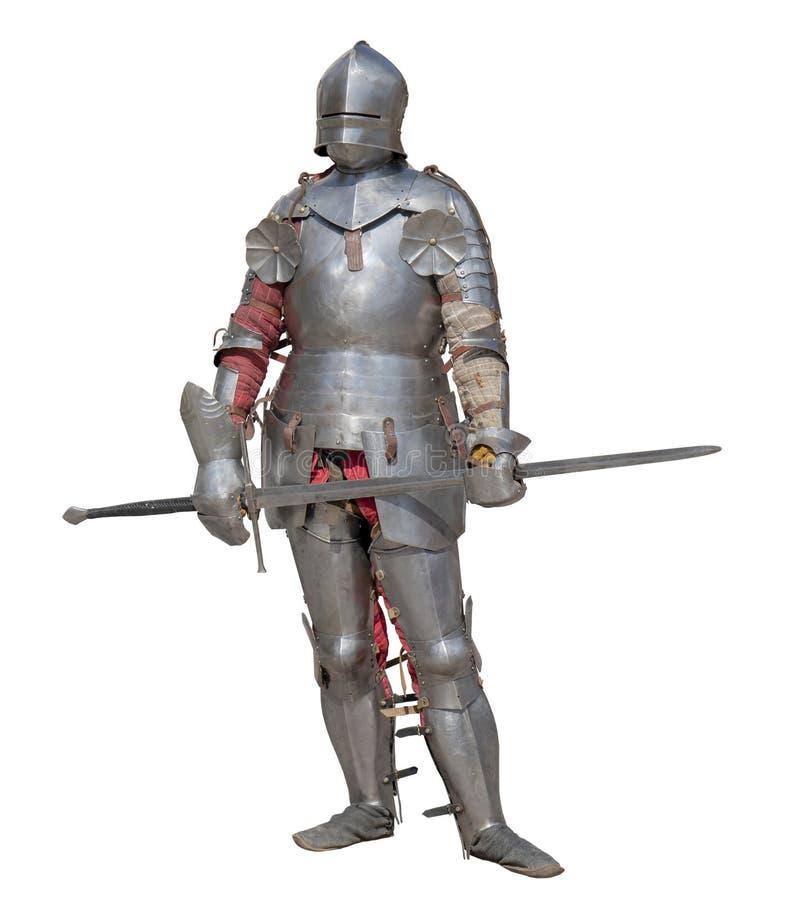 Caballero en armadura brillante del metal en un fondo blanco imágenes de archivo libres de regalías