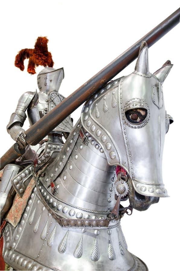 Caballero en el warhorse en blanco aislado foto de archivo