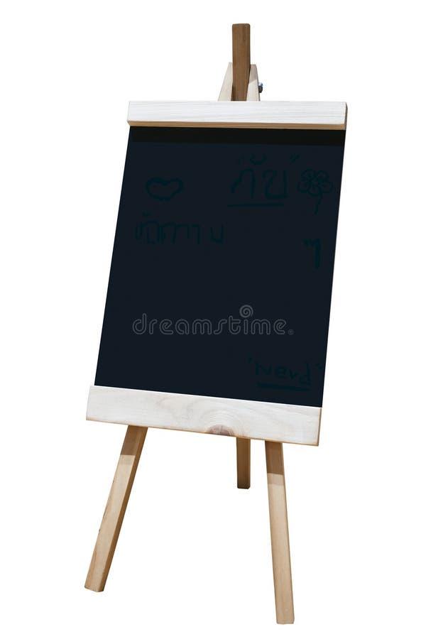 Caballete de madera con la muestra negra del capítulo del tablero aislada imágenes de archivo libres de regalías