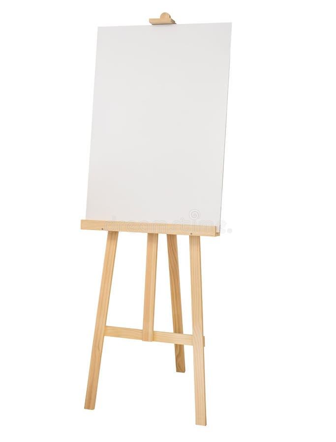 Caballete de madera de pintura del soporte con la lona en blanco imagenes de archivo