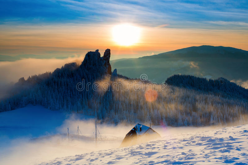 Caban in winter mountain on sunset stock photography