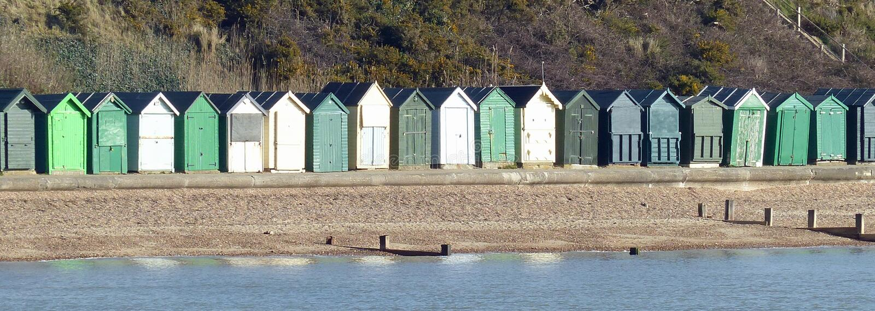 Cabanas da praia, Hampshire imagens de stock royalty free