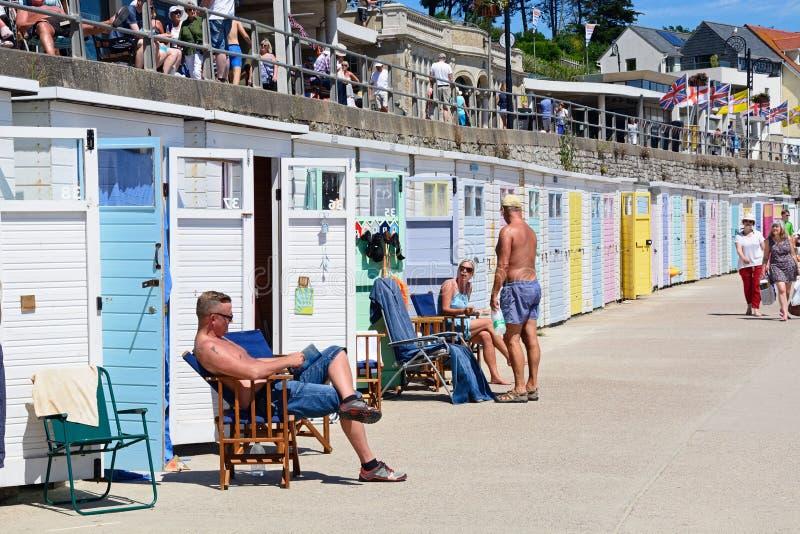 Cabanas da praia, Lyme Regis imagens de stock