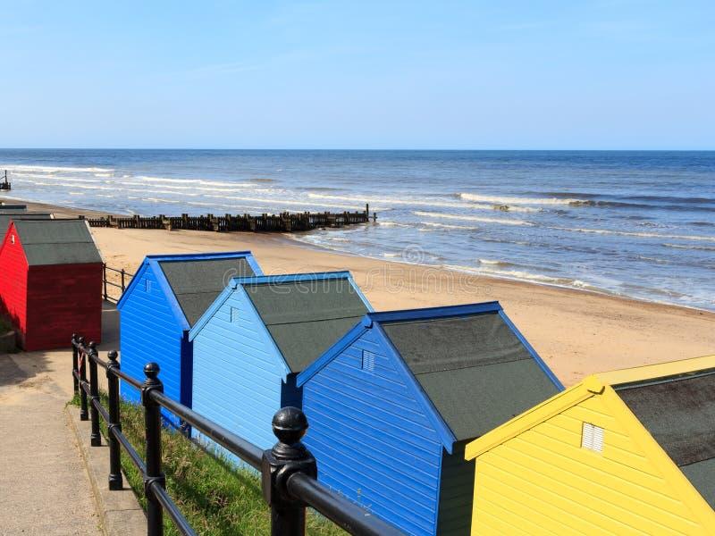 Cabanas Norfolk Inglaterra da praia de Mundesley fotos de stock royalty free