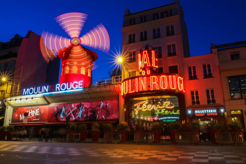 The cabaret famous Moulin Rouge at night,Montmartre area, Paris , France. stock images