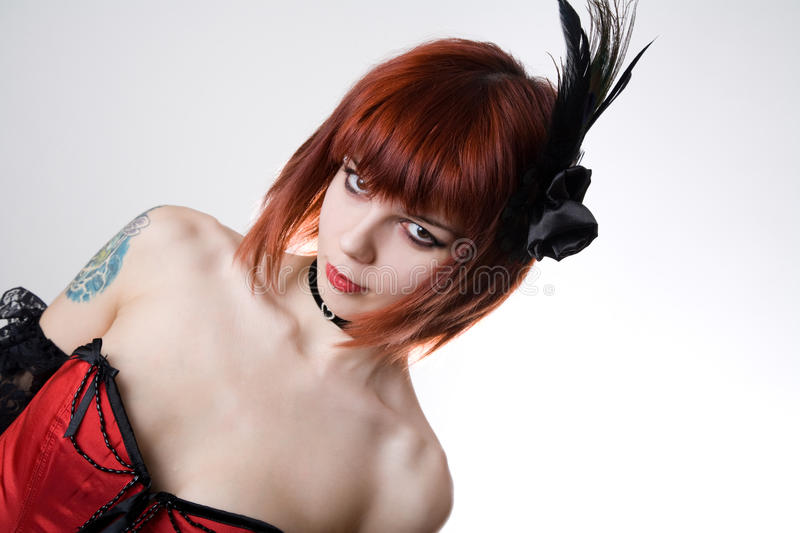 Cabaret girl with hair fascinator royalty free stock photo