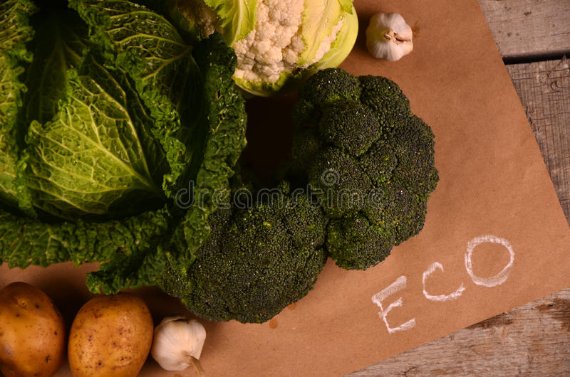 Cabbage, cauliflower , broccoli and hand drawn sign the eco product on black royalty free stock images