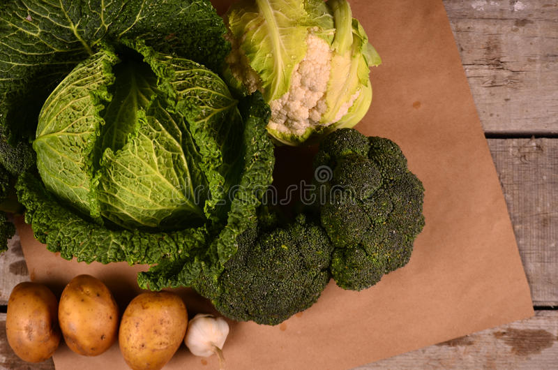 Cabbage, cauliflower , broccoli and hand drawn sign the eco product on black stock images
