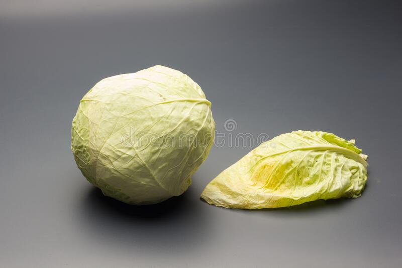 Cabbage, green and healthy winter vegetable. Freshly picked cabbage from the garden, winter vegetable, healthy and ideal for vegetarian meals; winter meals stock images