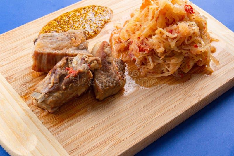 Cabbage pork dinner food braised,  gourmet. Cabbage pork dinner food braised meat ribs,  gourmet royalty free stock images