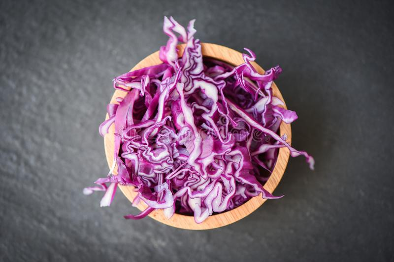 Cabbage purple / Shredded red cabbage slice in a wooden bowl and dark background. Top view royalty free stock images