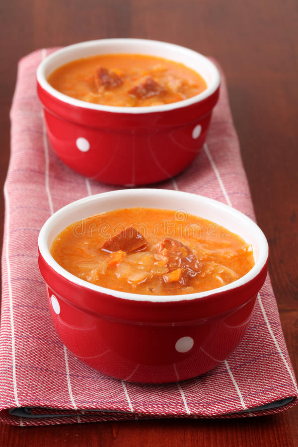 Cabbage and red pepper soup. Cabbage soup made from sauerkraut with red pepper royalty free stock photos