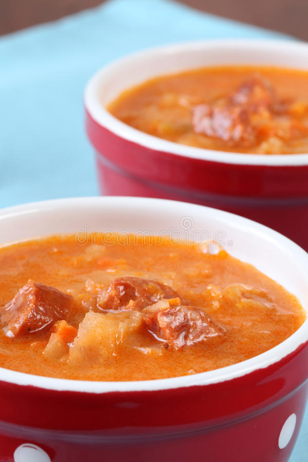 Cabbage and red pepper soup. Cabbage soup made from sauerkraut with red pepper royalty free stock images