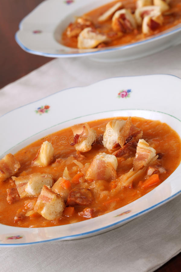 Cabbage and red pepper soup. Cabbage soup made from sauerkraut with red pepper stock photos