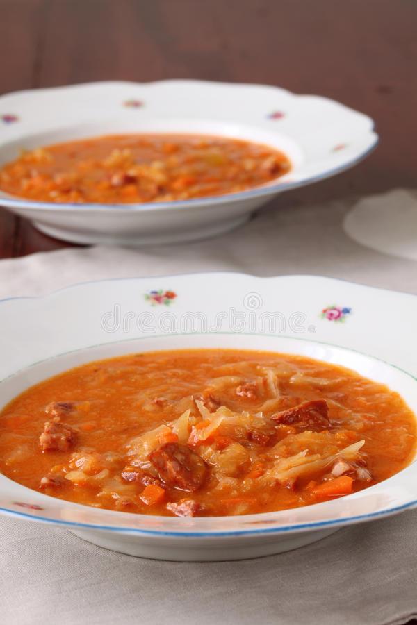 Cabbage and red pepper soup. Cabbage soup made from sauerkraut with red pepper stock photo