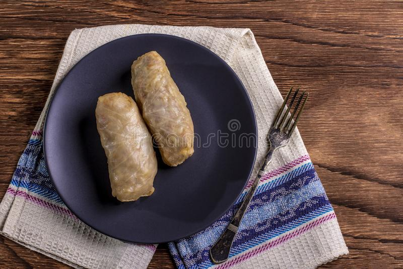 Cabbage rolls with beef, rice and vegetables. Stuffed cabbage leaves with meat. Dolma, sarma, sarmale, golubtsy or golabki. Horizontal royalty free stock photo