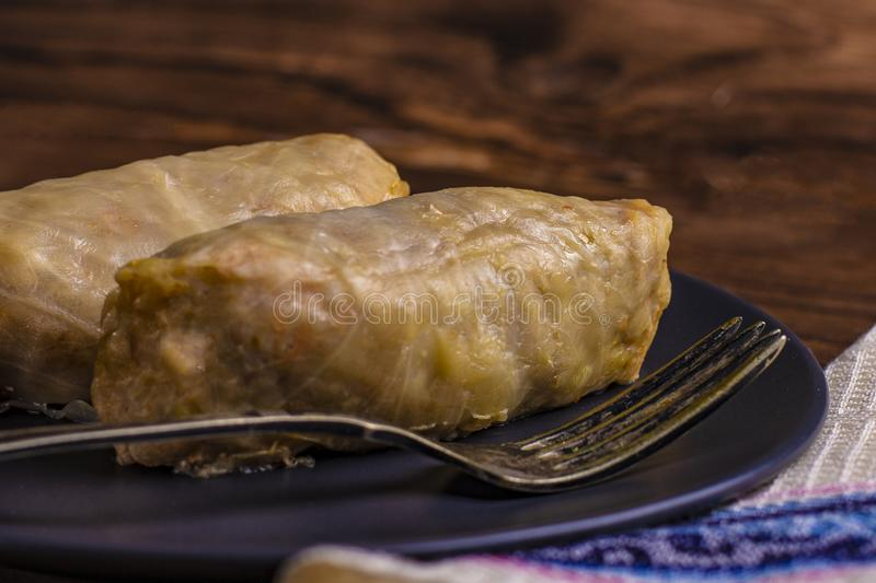 Cabbage rolls with beef, rice and vegetables. Stuffed cabbage leaves with meat. Dolma, sarma, sarmale, golubtsy or golabki. Horizontal stock photo