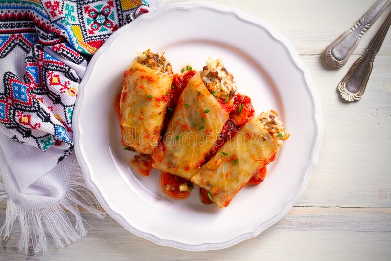 Cabbage rolls with meat, rice and vegetables. Chou farci, dolma, sarma, sarmale, golubtsy - popular dish in many countr. Cabbage rolls with meat, rice and royalty free stock image