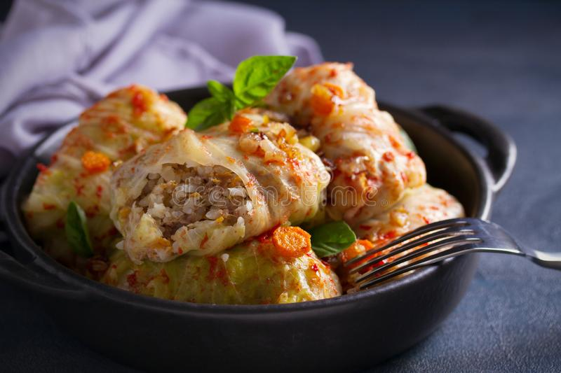 Cabbage rolls with meat, rice and vegetables. Stuffed cabbage leaves with meat. Chou farci, dolma, sarma, golubtsi or golabki. Cabbage rolls with meat, rice and royalty free stock image