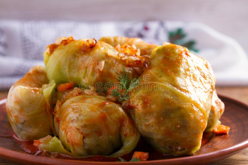 Cabbage rolls with meat, rice and vegetables. Stuffed cabbage leaves with meat. Chou farci, dolma, sarma, golubtsy or golabki. Cabbage rolls with meat, rice and royalty free stock photo