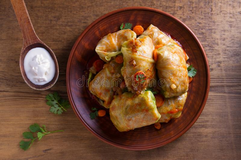 Cabbage rolls with meat, rice and vegetables. Stuffed cabbage leaves with meat. Chou farci, dolma, sarma, golubtsy or golabki. View from above, top studio shot royalty free stock image