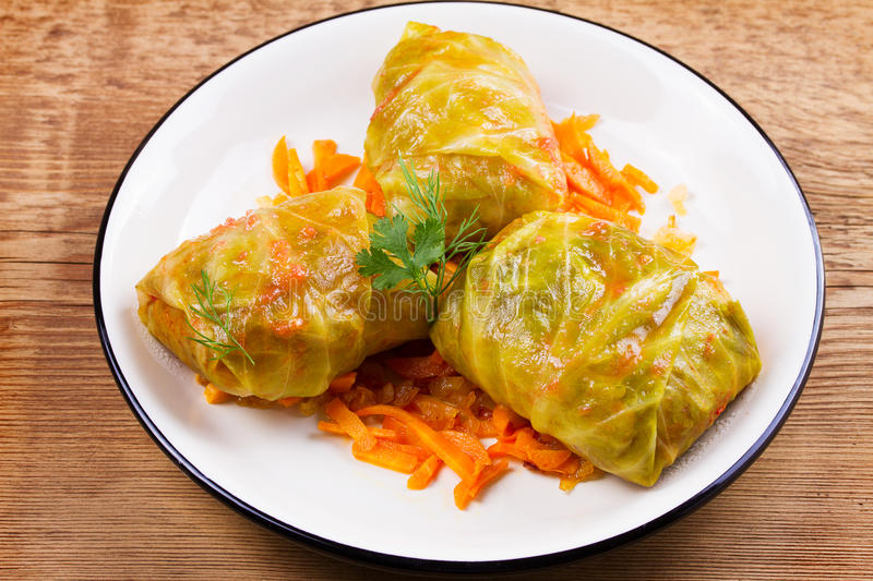 Cabbage rolls with meat; rice and vegetables. Stuffed cabbage leaves with meat. Dolma; sarma; sarmale; golubtsy or golabki. Traditional and popular dish in stock photo