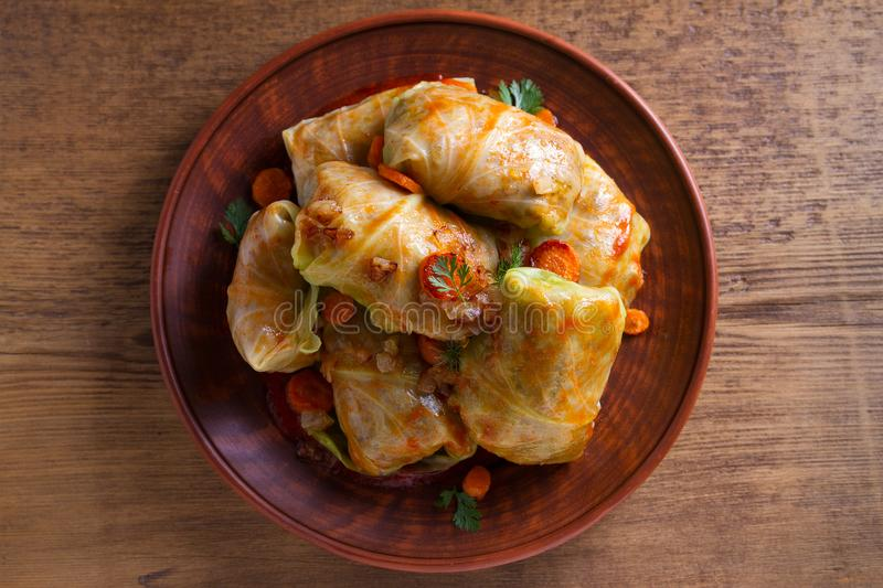 Cabbage rolls with meat, rice and vegetables. Stuffed cabbage leaves with meat. Chou farci, dolma, sarma, golubtsy or golabki. View from above, top studio shot stock image