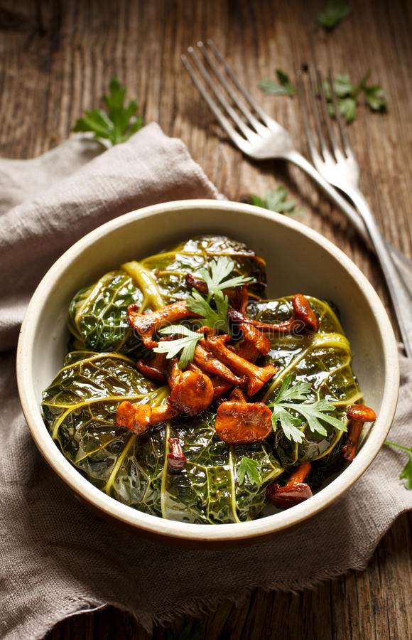 Cabbage rolls, savoy cabbage stuffed with rice and mushrooms stock images