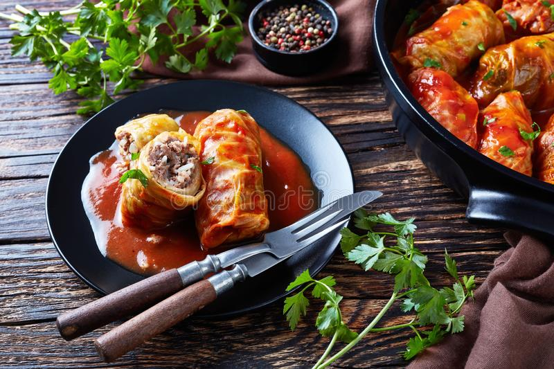 Cabbage rolls served on a black plate stock photo