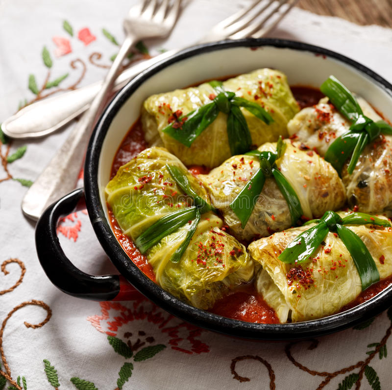 Cabbage rolls, stuffed cabbage with rice and vegetables in tomato sauce stock images