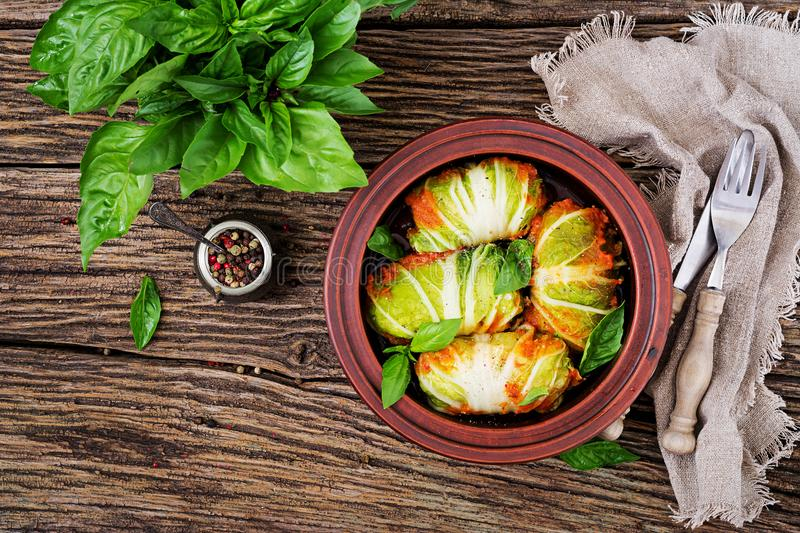 Cabbage rolls stuffed with rice with chicken fillet in tomato sauce stock photo