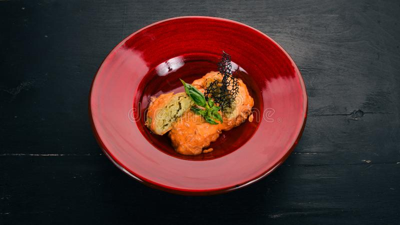 Cabbage rolls with tomato sauce in a red plate. stock images